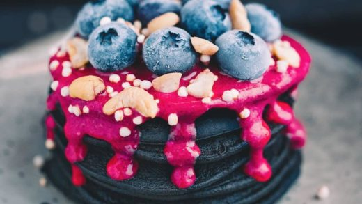 Black charcoal pancakes with raspberry sauce, cashews and blueberries by   . Follow  for daily foodgasm! . . .   . . .                      …