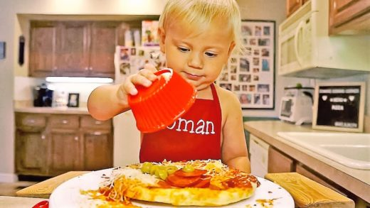 A 2-YEAR-OLD BOY COOKS HIS OWN PIZZA
