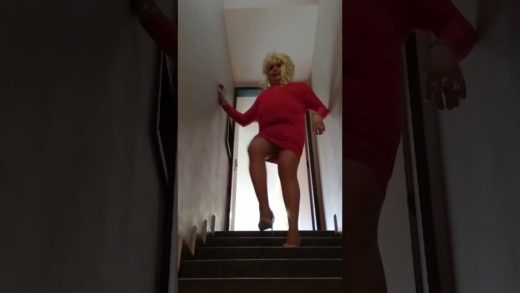 Carolina crossdresser MILF secretary high heels, pantyhose, sexy legs seduction on stairs mini dress