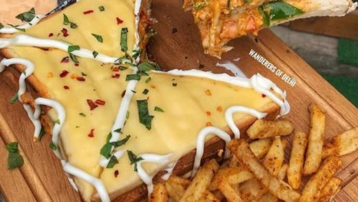 Take a dip in CHEESE-WELL SANDWICH!!  Tag all Cheese Maniacs! . Pic by   . Droolicious Triple layered Sandwich topped with baked cheese & fries from Shake it Up, Hudson Lane, Delhi . .                ...