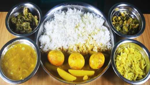 egg curry, poo spinach, lady's finger fry, potato fry & dal eating with rice