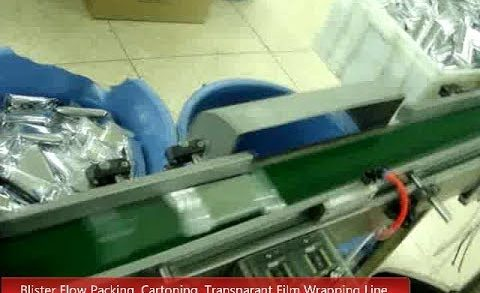 Blister flow pack, cartoning and wrapping by transparant film assembly line