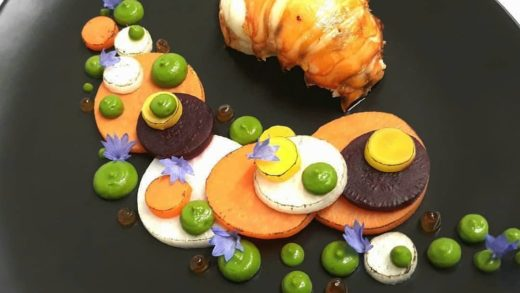 "By  ""Langoustine, green peas puree, sweet potato, daikon velute sauce..."" .                           ..."
