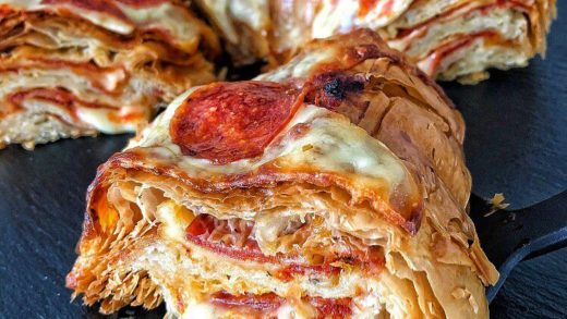 Pepperoni Pizza Croissant Cake. There's over 30 layers or cheesy, saucy, pepperoni deliciousness inside each piece....