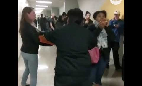 Volunteers hand out pizza to hungry voters in long lines