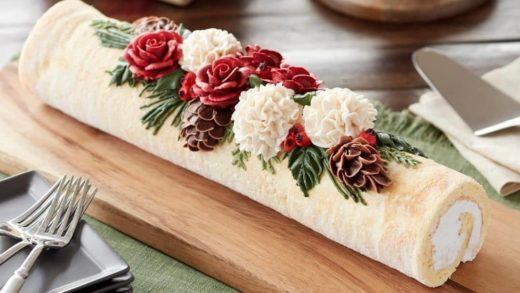 YES or No? - Take your classic Yule log to the next level!  - Covered in ivory-tinted icing and decorated with icing roses, carnations, pine and holly, serve this unique cake at a Christmas party!  - Start to bake with ...