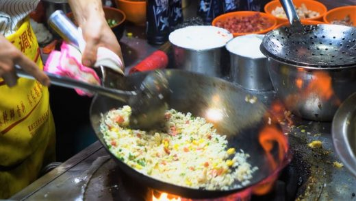 Chinese Street Food -Fried rice with egg fried noodles, grilled squid , Cantonese rice rolls