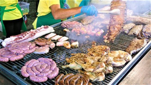 Italy Street Food Festival. Huge Grill, Roasted Piglet, Pork and Lamb Skewers, PitaGyros, Sweets