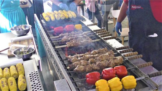 Street Food in Kyiv, Ukraine. Grilled Meat, Fried Fish, Sausages, Noodles, Cheese and more Food