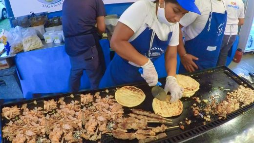 Street food from Greece. Fast Preparation of Pita Gyros with Lamb, Pork and Chicken. Italian Event