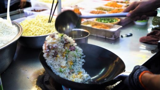 Chinese Street Food -Fried rice with eggs. fried potatoes at food stalls,  fried dough sticks